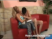 Blonde breastfeeds adult baby and fucks him with a strapon
