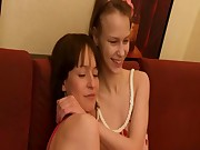 Two bored girls on the couch make oral