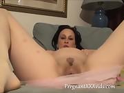 Pregnant MILF fingering her sweet pussy