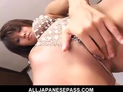 MILF in rhinestones fingers and toys her trimmed pussy